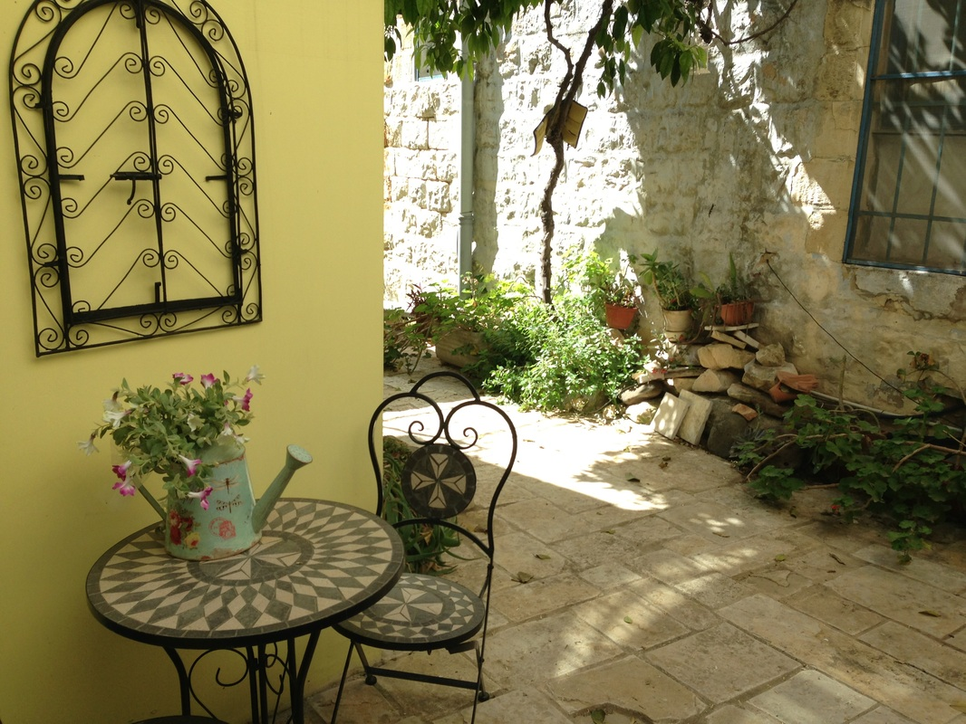 Family vacations in Israel. A courtyard at Villa Tiferet, Tsfat.