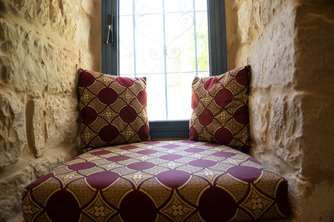 Stone nook with pillows in ktichen of Villa Tiferet, Tsfat.